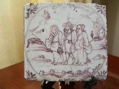 17th century manganese delf tile of three figures travelling on a road