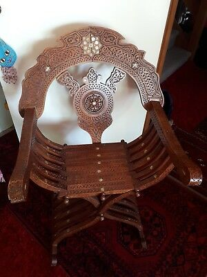 Savonarola  1970's asian style heavily carved foldable chair, unusual.