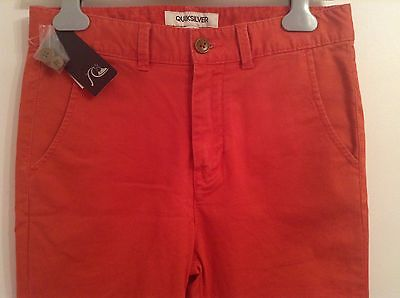 BNWT 100% Auth Quiksilver, Boys Red Straight Chinos trousers. 14 yrs