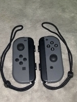 Nintendo Switch JoyCon Controllers Grey L and Grey R - Brand New Condition.