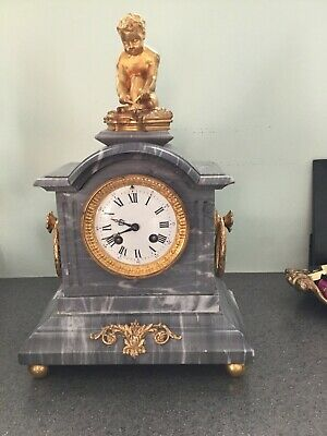Antique French grey marble clock with gilt bronze figurine, early 20 c.
