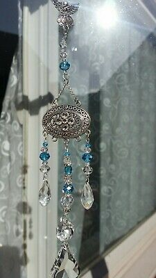 Hand made Guardian angel crystal sun catcher/dream catcher to watch over you.