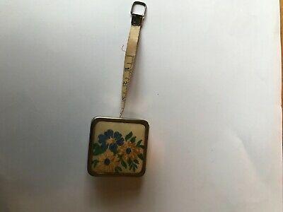 A Vintage Embroidered Miniature Tape Measure