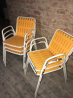 Set of five mid century vintage retro industrial tubular stacking chairs