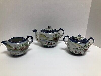 antique hand painted ,signed Five Piece Teapot Set.  Blue Trimmed With Geishas