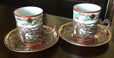 A Pair Of Oriental Eggshell Porcelain And Copper Dragon Cups And Saucers