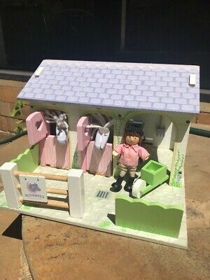 Wooden dolls house horse stables