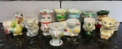 Collection of 13 vintage retro china egg cups character figures