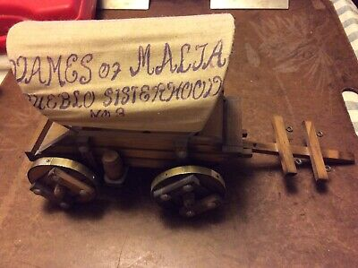 Vintage Wooden Covered Wagon with a Cloth Cover
