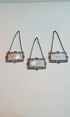 Vintage sterling silver decanter  labels   set of 3