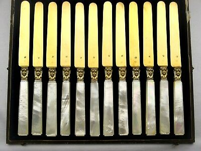 12 FRENCH VERMEIL MINERVE SILVER GILDED MOP KNIVES HEAD OF DOG circa 1840