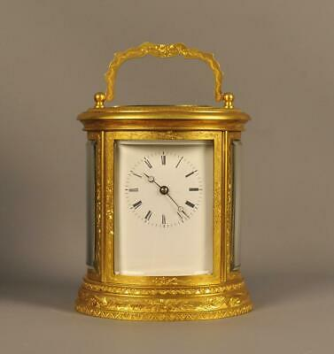 Oval Engraved Striking Carriage Clock