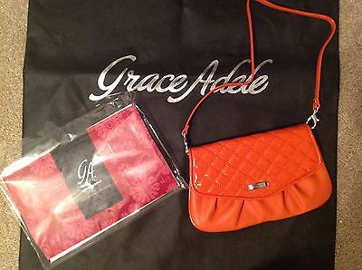 Brand New Grace Adele Elegant Jane Orange Clutch with tags on