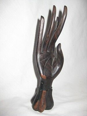 carved hard wooden hand wood statue ladies lady arm fingers African carving ?