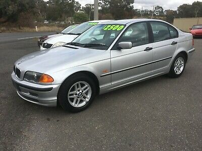 1998 BMW E46 sedan 4 cylinder manual WHEELS HAVE BEEN CHANGED