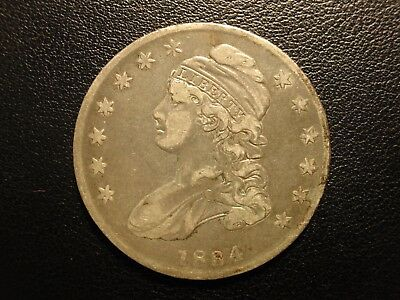 1834 capped bust half dollar, small date, stars, and letters