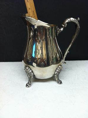 vintage large silverplated footed water pitcher with ice llip