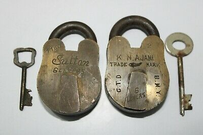 A pair of vintage old brass solid padlock with key decorative locks