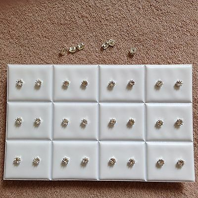 JOBLOT-12 pairs of 0.5cm crown set crystal diamante stud earrings. Silver plated