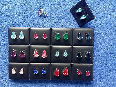 JOBLOT - 12 pairs of pear shape colour diamante stud earrings.Silver plated.