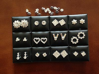 JOB LOT-12 pairs of 12 different shapes crystal diamante studs earrings.UK made.