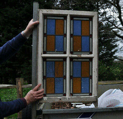 Beautiful 8 leaded light stained glass panels in blue, amber, red and clear
