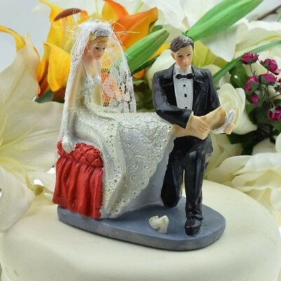 Groom Fitting Shoe on Bride - Bride and Groom Wedding Cake Topper