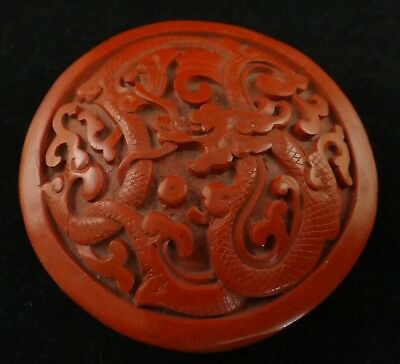 "Antique Chinese Carved Cinnabar Round Lidded Box, Dragon, early 20th.  2 7/8"" d."
