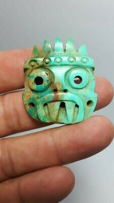 Pre-Columbian Mixtec Tlaloc turquoise pendant from Mexico. 1000 ad.