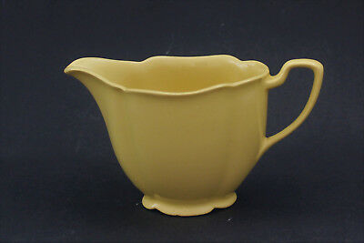 Vintage yellow petal shaped milk jug. Made in England.