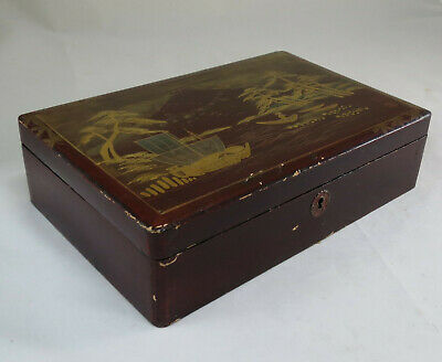 Japanese lacquered wood box decorated with gilded landscape;  Circa 1900;