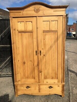 Large, antique pine,carved,double wardrobe,two drawers, cornice, original key.