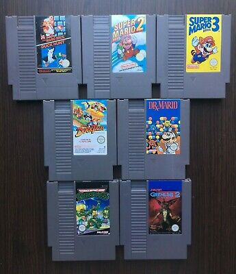 Lot 12 jeux Nintendo Nes Pac-man ,Yoshis Cookie ..........