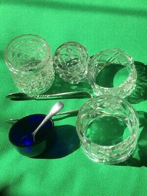 selection of crystal , and blue liner with spoon and tongs