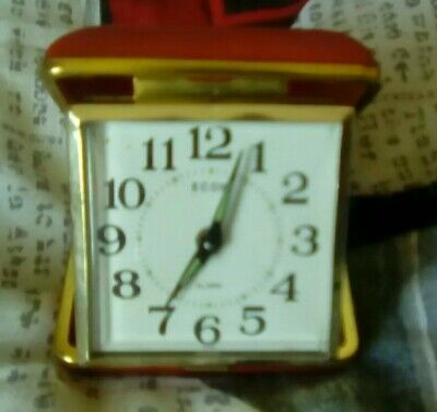VINTAGE RETRO ECON TRAVEL ALARM CLOCK WITH RED CLAM SHELL CASE wind up