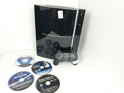 Sony PlayStation 3 Charcoal Black Consol + 4 Free PS3, PS2 Games (CECHK03)