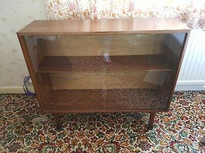 Pair of Mid century glass-doored teak cabinets by Beaver & Tapley