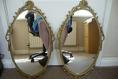 Pair Of Ornate Metal Gilt Oval Mirrors.