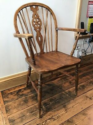 Windsor wheel back wooden chair with arms