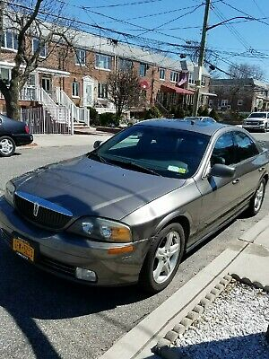 2002 Lincoln LS  A nice looking 3.9L V8, heated seats,ieather seats, sun roof.