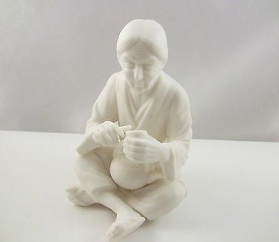 White Bisque Figurine Of An Asian Woman Sitting Cross Legged Drinking Tea-4-3/4""
