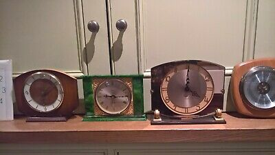 4 vintage/ retro clocks and a barometer