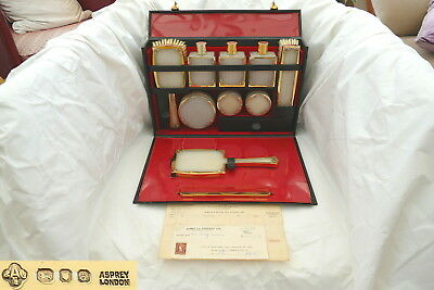 VERY RARE CASED QE II HM STERLING SILVER GILT DRESSING TABLE SET by ASPREY