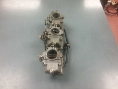 Carburetors for a 75 HP Johnson or Evinrude outboard motor 1975