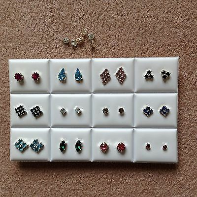 JOB LOT-12 pairs of mix coloured diamante stud earrings.Silver plated.Made in UK