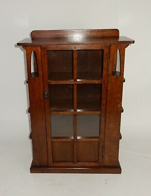 Limbert Style Cut out book case with side shelves and single door