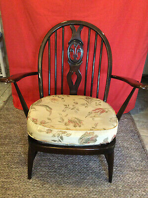 Vintage Ercol Fleur de Lys pattern elm chair,  with arms and cushion