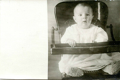 Cute Baby Boy in Wooden High Chair-Knit Booties-Vintage RPPC Real Photo Postcard