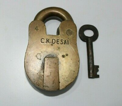 An or Antique brass solid and heavy 4 levers padlock or lock with key UNUSUAL