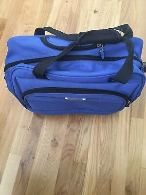 """Delsey Blue Rolling Bag with Extendable Handle16""""x12""""x6"""" in Miami."""